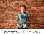 cute schoolgirl with schoolbag... | Shutterstock . vector #1377408422