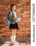cute schoolgirl with schoolbag... | Shutterstock . vector #1377408428