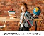 cute schoolgirl with schoolbag  ... | Shutterstock . vector #1377408452