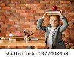 cute schoolgirl sitting at the... | Shutterstock . vector #1377408458