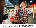 two male friends buying popcorn ... | Shutterstock . vector #1377408578