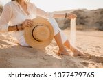 woman holding straw hat in hand ... | Shutterstock . vector #1377479765