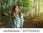 young woman taking a walk in... | Shutterstock . vector #1377515312
