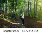 young woman taking a walk in... | Shutterstock . vector #1377515315