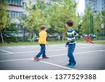 happy two brother kids playing... | Shutterstock . vector #1377529388