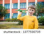 happy kid playing with toy... | Shutterstock . vector #1377530735