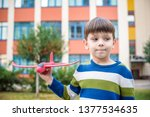 happy kid playing with toy... | Shutterstock . vector #1377534635