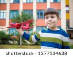 happy kid playing with toy... | Shutterstock . vector #1377534638