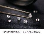 gemstone clamped in tweezers.... | Shutterstock . vector #1377605522