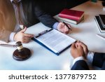 lawyer sitting working at the... | Shutterstock . vector #1377879752