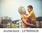 playful family bonding. mother... | Shutterstock . vector #1378000628