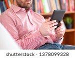one man reading a book in an... | Shutterstock . vector #1378099328