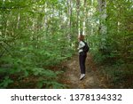 young woman taking a walk in... | Shutterstock . vector #1378134332