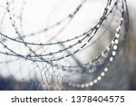 coiled sharp barbed wire ... | Shutterstock . vector #1378404575