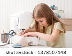little girl carefully working... | Shutterstock . vector #1378507148