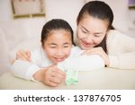 mother and daughter with the... | Shutterstock . vector #137876705