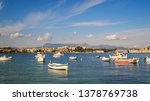 wooden fishing boats in harbor... | Shutterstock . vector #1378769738