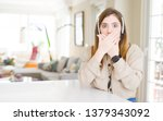 Stock photo beautiful young operator woman wearing headset at the office shocked covering mouth with hands for 1379343092