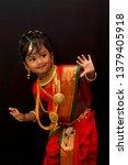 little indian girl posing in a... | Shutterstock . vector #1379405918