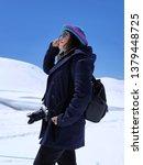 asian female tourists take... | Shutterstock . vector #1379448725
