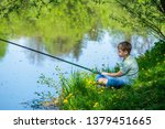 Young Kid Fishing Alone On...