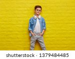 confident boy in stylish outfit ... | Shutterstock . vector #1379484485