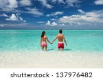couple on a tropical beach at... | Shutterstock . vector #137976482
