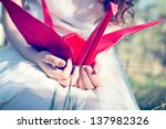 girl with red origami crane | Shutterstock . vector #137982326