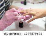 closeup females hands getting... | Shutterstock . vector #1379879678