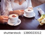 woman holding hot cup of coffee ...   Shutterstock . vector #1380023312
