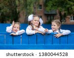 three girl schoolgirl... | Shutterstock . vector #1380044528