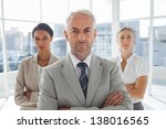 serious businessman standing in ... | Shutterstock . vector #138016565