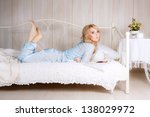 beautiful blonde on the bed | Shutterstock . vector #138029972