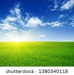 green field  blue sky and sun.    Shutterstock . vector #1380340118