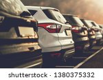 electric cars SUVs parked in row on dealership parking - stock photo