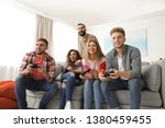 emotional friends playing video ... | Shutterstock . vector #1380459455