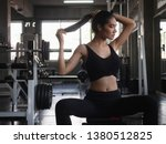 relaxing after training in gym... | Shutterstock . vector #1380512825