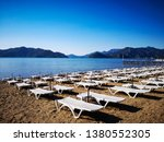 view of sunbeds on the beach in ... | Shutterstock . vector #1380552305