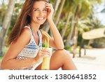 happy girl is drinking fruit...   Shutterstock . vector #1380641852