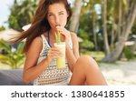 happy girl is drinking fruit...   Shutterstock . vector #1380641855