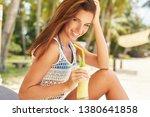 happy girl is drinking fruit...   Shutterstock . vector #1380641858
