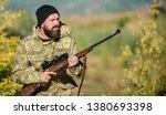 bearded hunter spend leisure... | Shutterstock . vector #1380693398