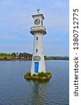 Small photo of Cardiff, County of Cardiff / Wales UK - 4/22/2019: The Scott Memorial, in Roath Park Lake, commemorates the ill-fated British Antarctic Expedition Trip aboard the ship Terra Nova on June 15th 1910.