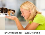 Stock photo loving teen girl playing with pet kitten at home 138075455