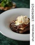 meat in bbq sauce standing on... | Shutterstock . vector #1380903425