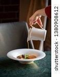 tomato cream suop standing on... | Shutterstock . vector #1380908612