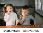 kids boy and girl eating ice... | Shutterstock . vector #1380930932