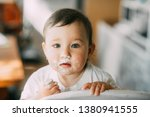baby portrait of a dirty... | Shutterstock . vector #1380941555