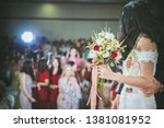 bride holding flower in hand to ... | Shutterstock . vector #1381081952