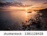 golden sunrise at stony beach... | Shutterstock . vector #1381128428